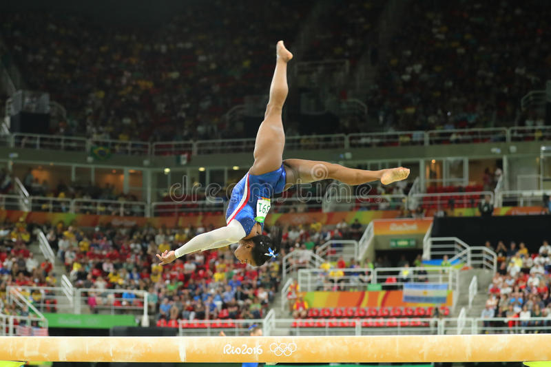 Olympic champion Simone Biles of United States competes on the balance beam at women`s all-around gymnastics at Rio 2016. RIO DE JANEIRO, BRAZIL - AUGUST 11 royalty free stock photos