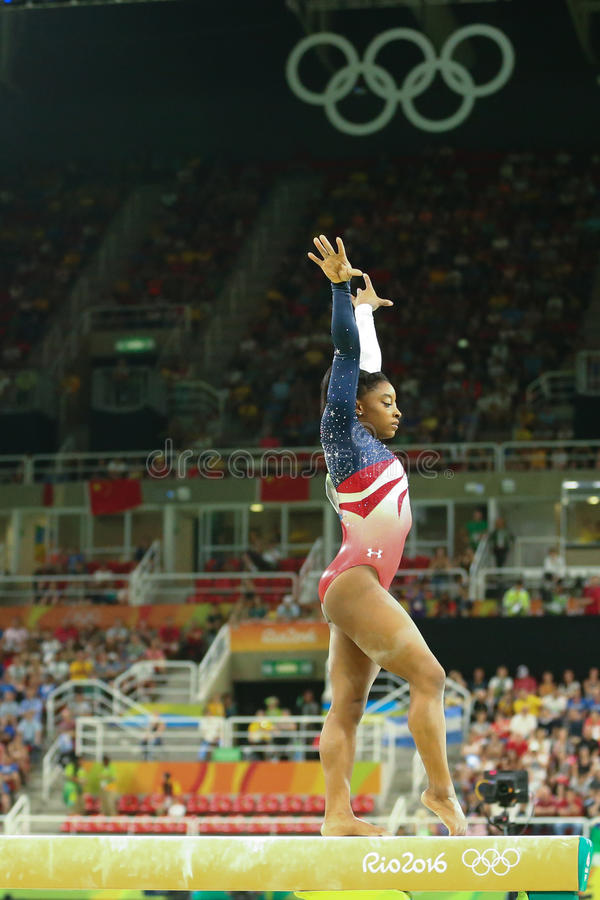 Olympic champion Simone Biles of United States competes on the balance beam at women's team all-around gymnastics at Rio 2016. RIO DE JANEIRO, BRAZIL - AUGUST 9 stock photography