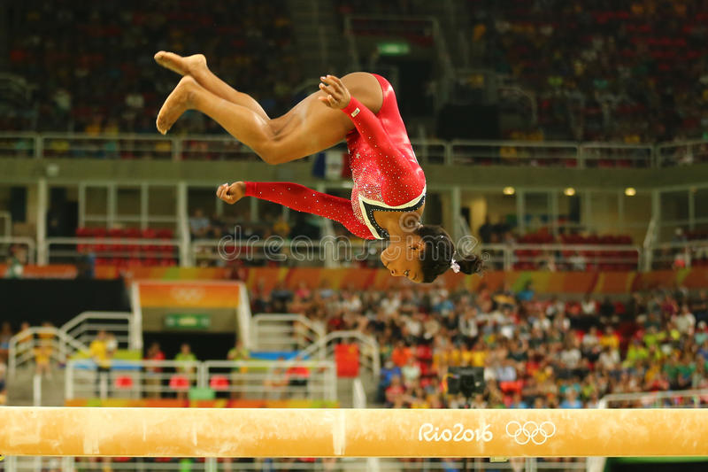 Olympic champion Simone Biles of United States competes at the final on the balance beam women`s artistic gymnastics at Rio 2016. RIO DE JANEIRO, BRAZIL AUGUST stock images