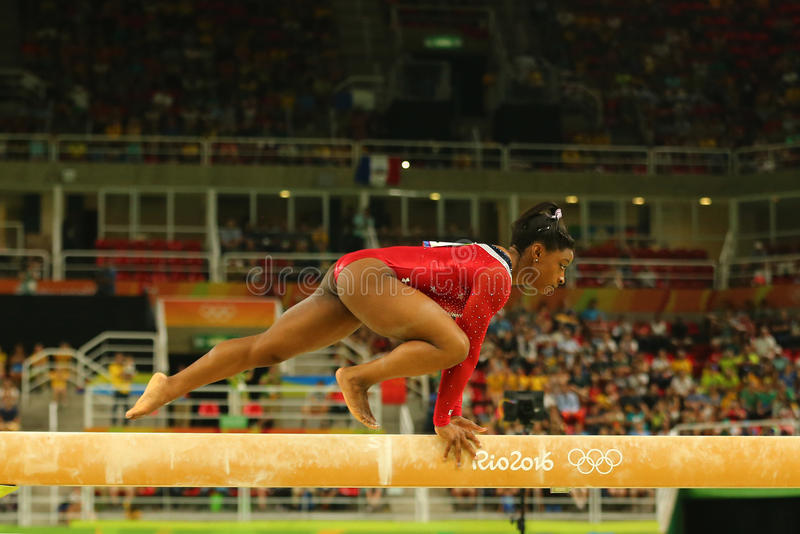 Olympic champion Simone Biles of United States competes at the final on the balance beam women`s artistic gymnastics at Rio 2016. RIO DE JANEIRO, BRAZIL AUGUST royalty free stock images