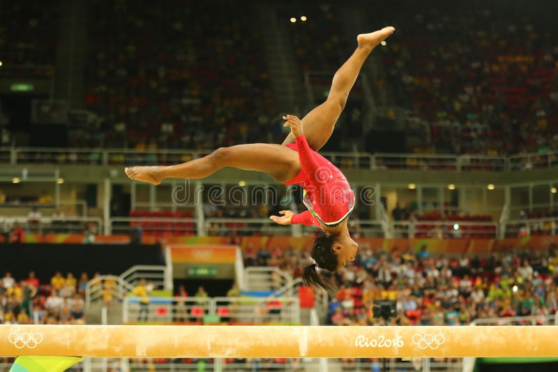 Olympic champion Simone Biles of United States competes at the final on the balance beam women`s artistic gymnastics at Rio 2016. RIO DE JANEIRO, BRAZIL AUGUST stock photography