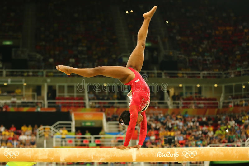 Olympic champion Simone Biles of United States competes at the final on the balance beam women`s artistic gymnastics at Rio 2016 stock images