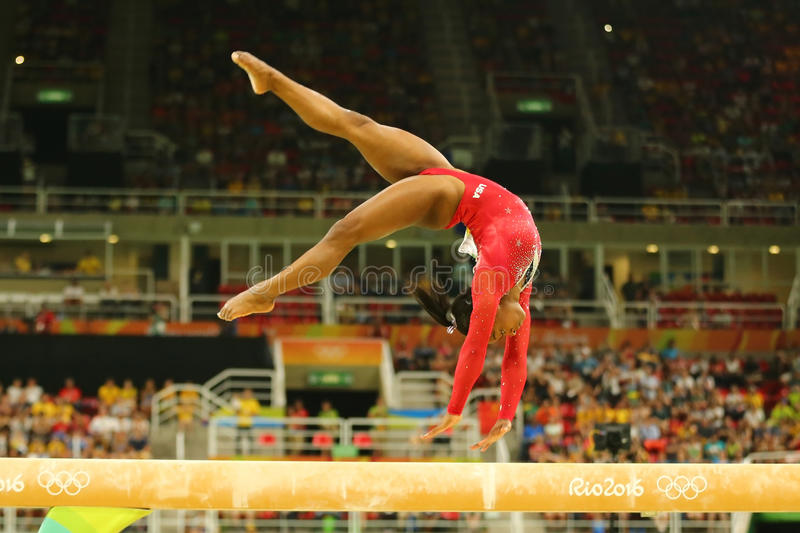 Olympic champion Simone Biles of United States competes at the final on the balance beam women`s artistic gymnastics at Rio 2016. RIO DE JANEIRO, BRAZIL AUGUST stock photo