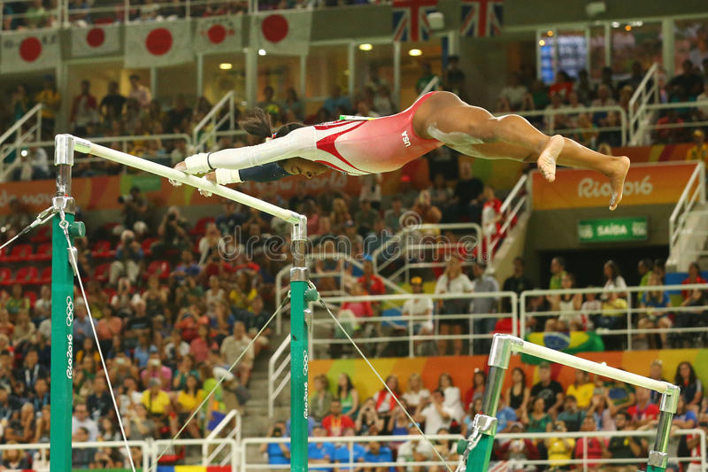 Olympic champion Simone Biles of United States competes on the uneven bars at women's team all-around gymnastics at Rio 2016. RIO DE JANEIRO, BRAZIL - AUGUST 9 stock photography