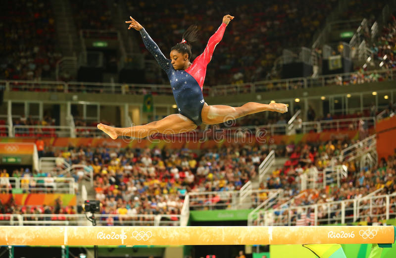Olympic champion Simone Biles of United States competing on the balance beam at women's all-around gymnastics qualification. RIO DE JANEIRO, BRAZIL AUGUST 7 stock images