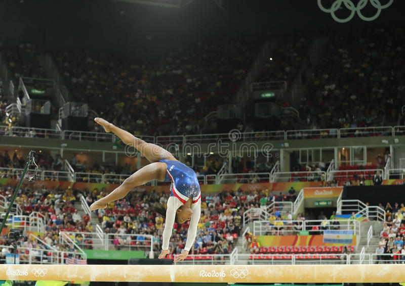 Olympic champion Simone Biles of United States competing on the balance beam at women's all-around gymnastics at Rio 2016. RIO DE JANEIRO, BRAZIL - AUGUST 11 stock images