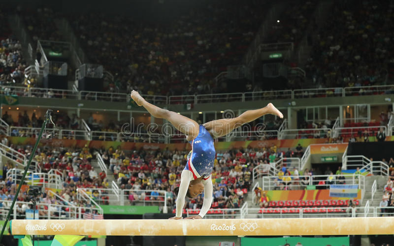 Olympic champion Simone Biles of United States competing on the balance beam at women's all-around gymnastics at Rio 2016. RIO DE JANEIRO, BRAZIL - AUGUST 11 royalty free stock photos