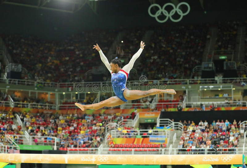 Olympic champion Simone Biles of United States competing on the balance beam at women's all-around gymnastics at Rio 2016 Oly. RIO DE JANEIRO, BRAZIL – stock photos