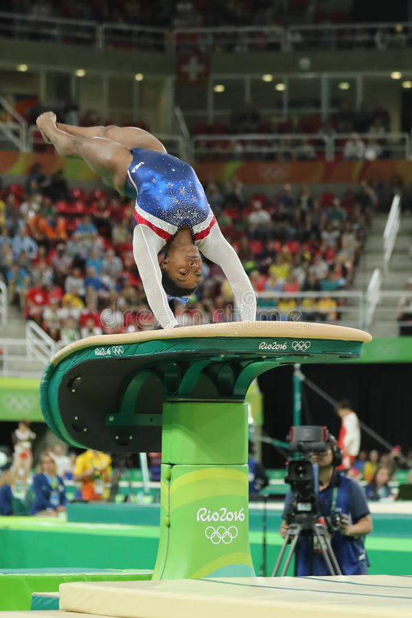 Olympic champion Simone Biles of United States competing a vault at women`s all-around gymnastics at Rio 2016 Olympic Games. RIO DE JANEIRO, BRAZIL - AUGUST 11 royalty free stock image