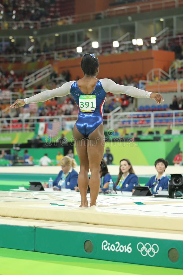 Olympic champion Simone Biles of United States competing a vault at women`s all-around gymnastics at Rio 2016 Olympic Games. RIO DE JANEIRO, BRAZIL - AUGUST 11 stock photo