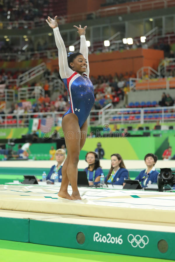 Olympic champion Simone Biles of United States competing a vault at women`s all-around gymnastics at Rio 2016 Olympic Games. RIO DE JANEIRO, BRAZIL - AUGUST 11 royalty free stock photos