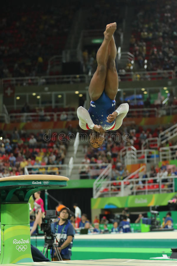 Olympic champion Simone Biles of United States competing a vault at women`s all-around gymnastics at Rio 2016 Olympic Games. RIO DE JANEIRO, BRAZIL - AUGUST 11 royalty free stock images