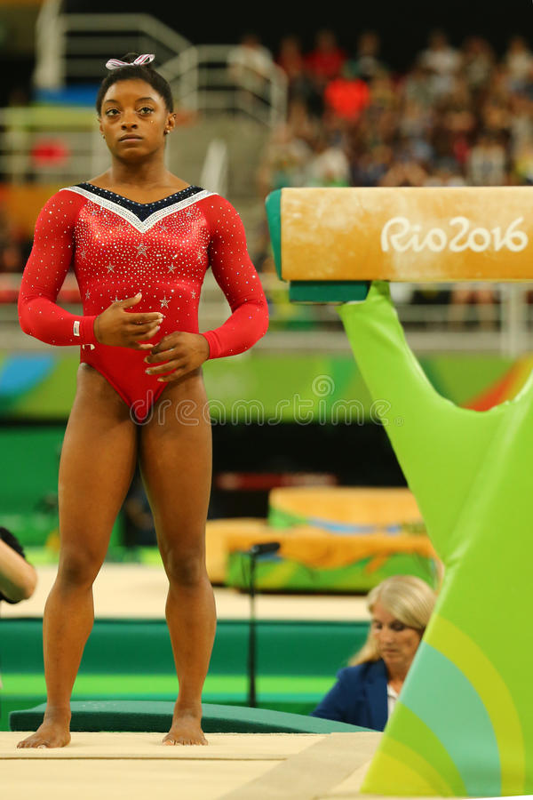 Olympic champion Simone Biles of United States before final competition on the balance beam women`s artistic gymnastics Rio 2016. RIO DE JANEIRO, BRAZIL - AUGUST stock photo