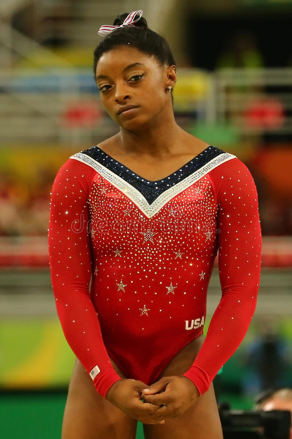 Olympic champion Simone Biles of United States before final competition on the balance beam women`s artistic gymnastics Rio 2016. RIO DE JANEIRO, BRAZIL - AUGUST royalty free stock image