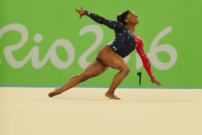 Olympic champion Simone Biles of USA competes on the floor exercise during women's all-around gymnastics qualification. RIO DE JANEIRO, BRAZIL - AUGUST 7, 2016 stock photo