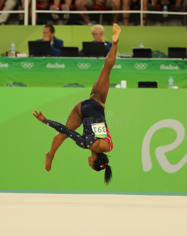 Olympic champion Simone Biles of USA competes on the floor exercise during women's all-around gymnastics qualification. RIO DE JANEIRO, BRAZIL - AUGUST 7, 2016 stock image