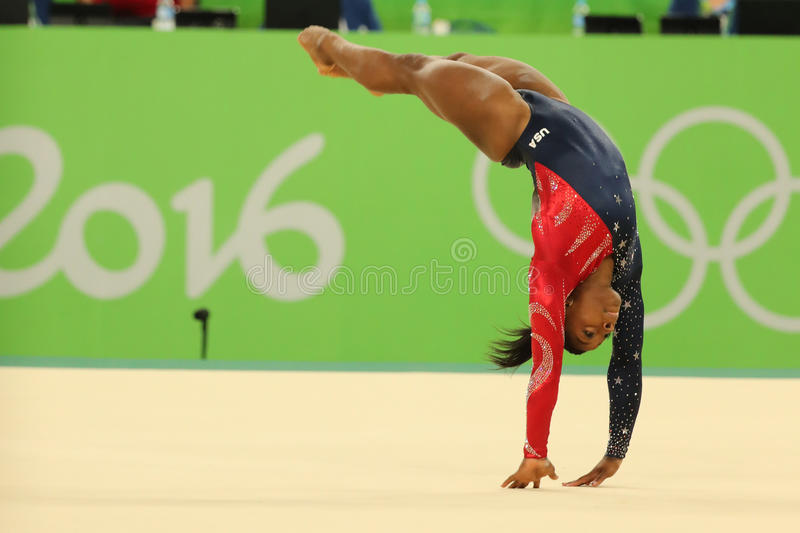 Olympic champion Simone Biles of USA competes on the floor exercise during women's all-around gymnastics qualification. RIO DE JANEIRO, BRAZIL - AUGUST 7, 2016 stock photography