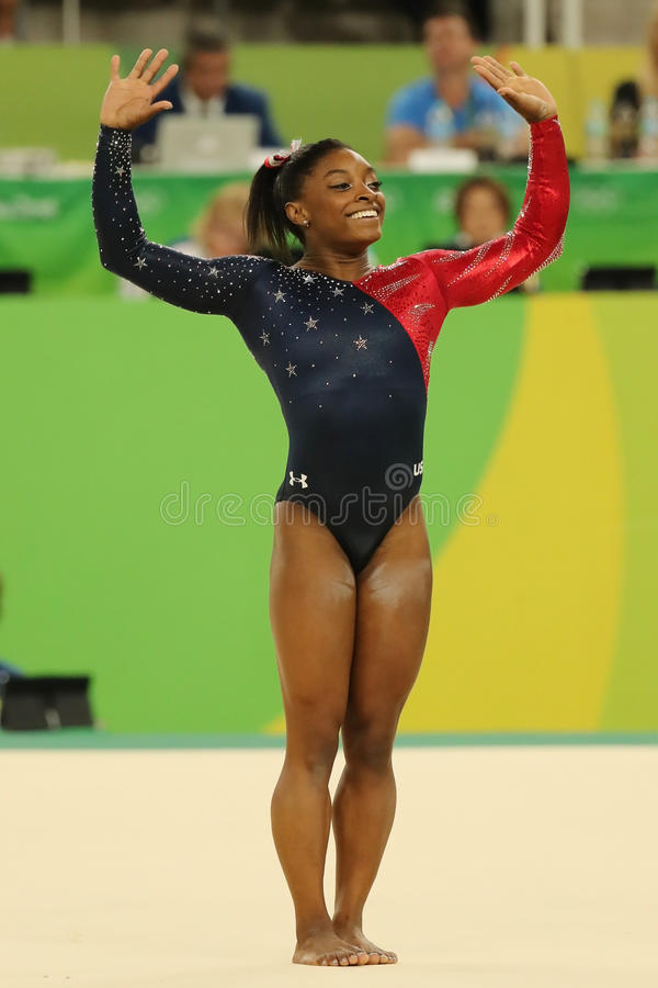 Olympic champion Simone Biles of USA competes on the floor exercise during women's all-around gymnastics qualification. RIO DE JANEIRO, BRAZIL - AUGUST 7, 2016 royalty free stock photo