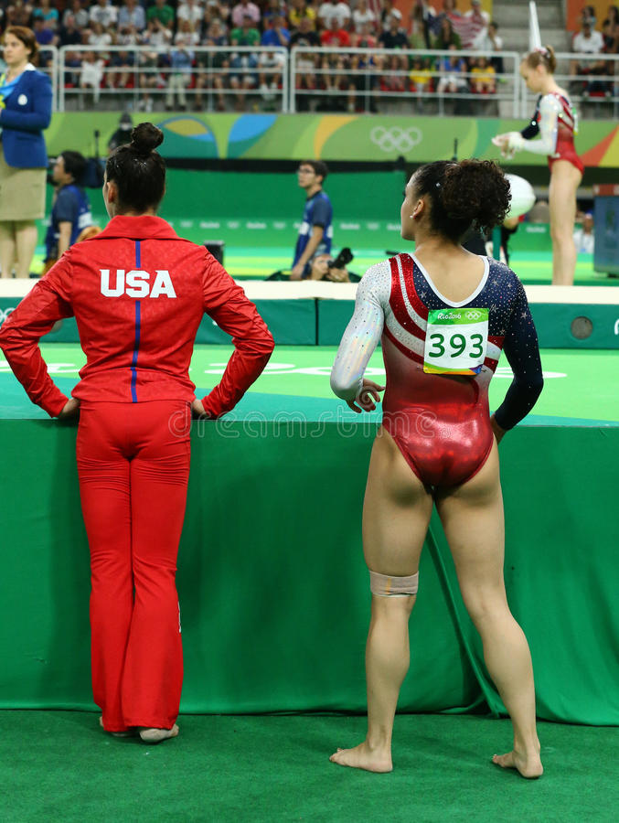 Olympic champions Aly Raisman (L) and Laurie Hernandez of USA during women's team all-around gymnastics. RIO DE JANEIRO, BRAZIL - AUGUST 9, 2016: Olympic stock images