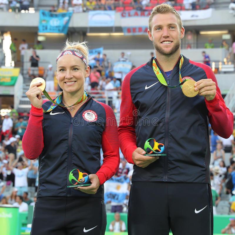Olympic champions Bethanie Mattek-Sands (L) and Jack Sock of USA during medal ceremony after victory at mixed doubles final. RIO DE JANEIRO, BRAZIL - AUGUST 14 royalty free stock images