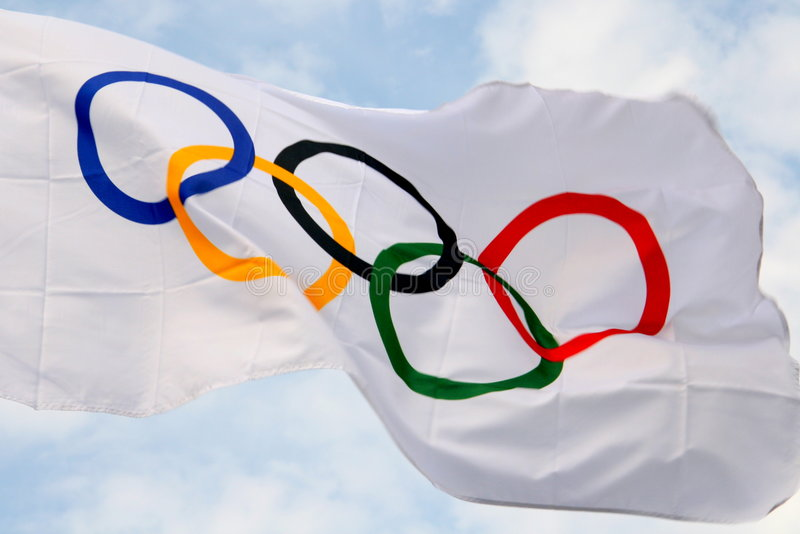 Olympic flag. Waving olympic flag in summertime