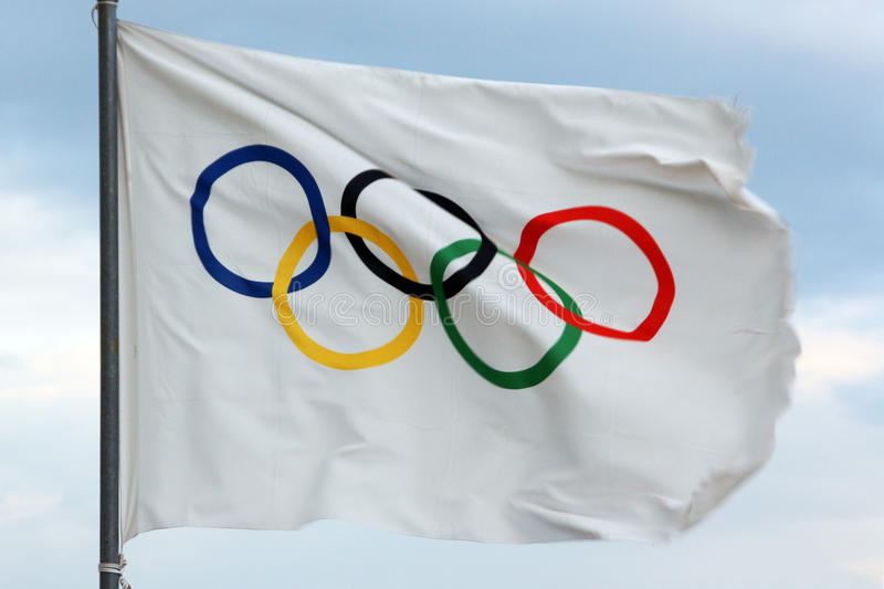 Olympic flag. Wind sport competition royalty free stock photography