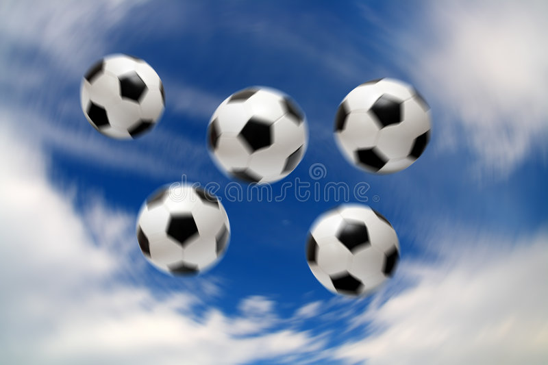 Olympic football soccer balls. Under blue sky with clouds stock images