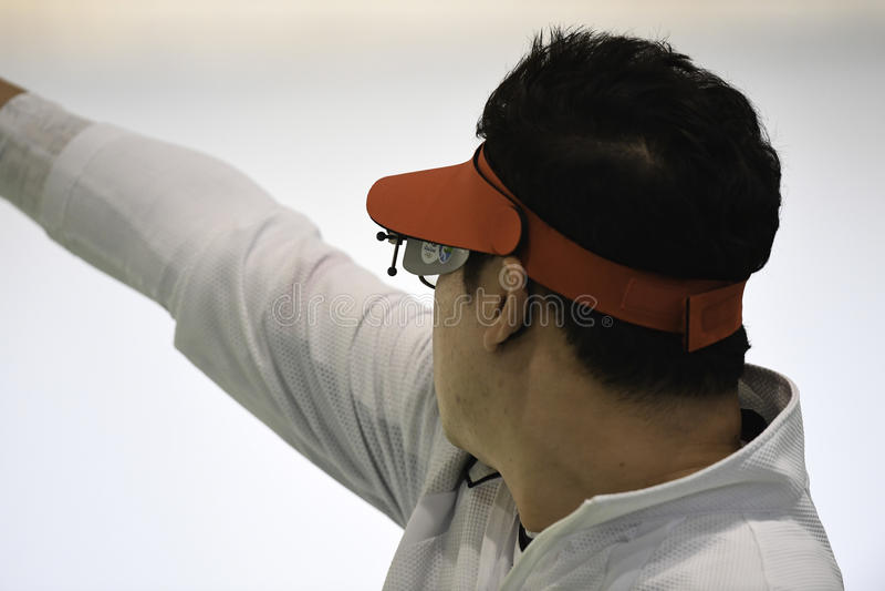 Olympic Games Rio 2016. Rio, Brazil - august 10, 2016: JIN Jongoh KOR during shooting 50m Pistol Men Shooting at Olympic Games 2016 in Olympic Shooting Centre stock images