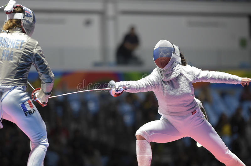 Olympic Games Rio 2016. Rio, Brazil - august 08, 2016: Velikaya S. RUS x Brunei M. FRA during the Fencing of the Rio 2016 Olympics Fencing held at the Carioca royalty free stock photo