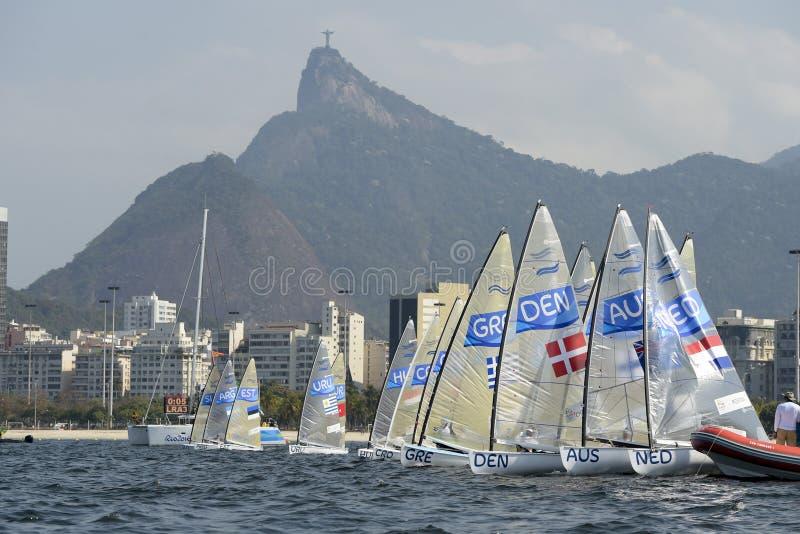 Olympic Games Rio 2016. Rio de Janeiro, Brazil - august 09, 2016: Start during Finn class sailboats in the regatta in the Gloria marina at the Rio 2016 Olympic stock image