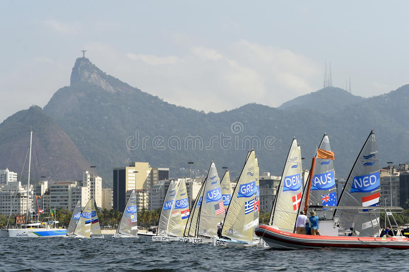 Olympic Games Rio 2016. Rio de Janeiro, Brazil - august 09, 2016: Start during Finn class sailboats in the regatta in the Gloria marina at the Rio 2016 Olympic stock images