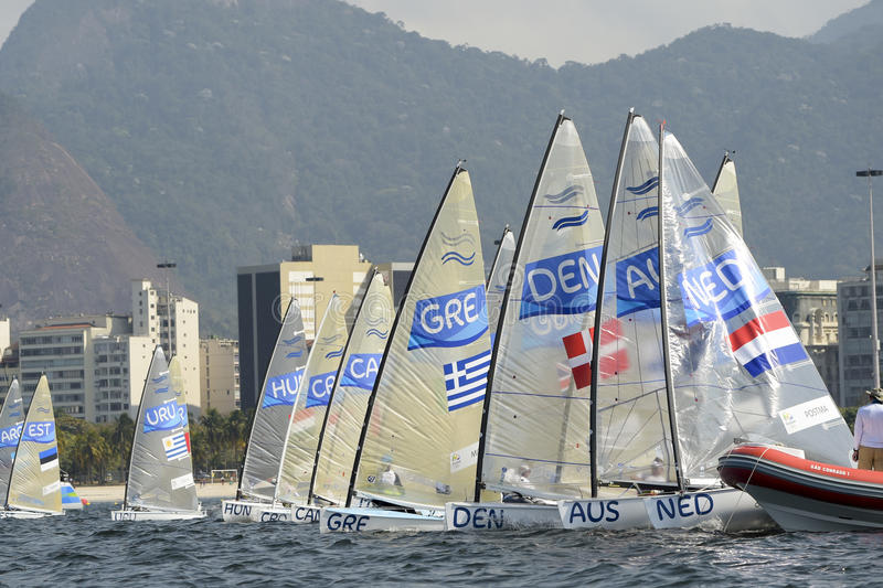 Olympic Games Rio 2016. Rio de Janeiro, Brazil - august 09, 2016: Start during Finn class sailboats in the regatta in the Gloria marina at the Rio 2016 Olympic royalty free stock images