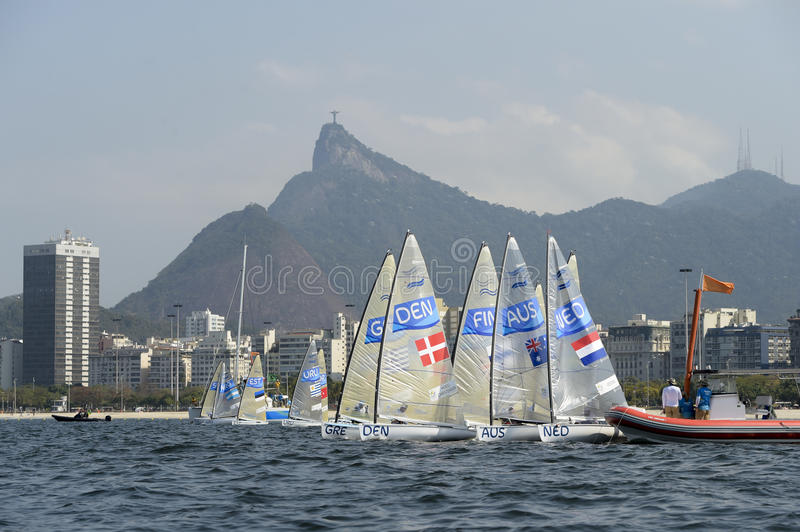 Olympic Games Rio 2016. Rio de Janeiro, Brazil - august 09, 2016: start during Finn class sailboats in the regatta in the Gloria marina at the Rio 2016 Olympic royalty free stock photos
