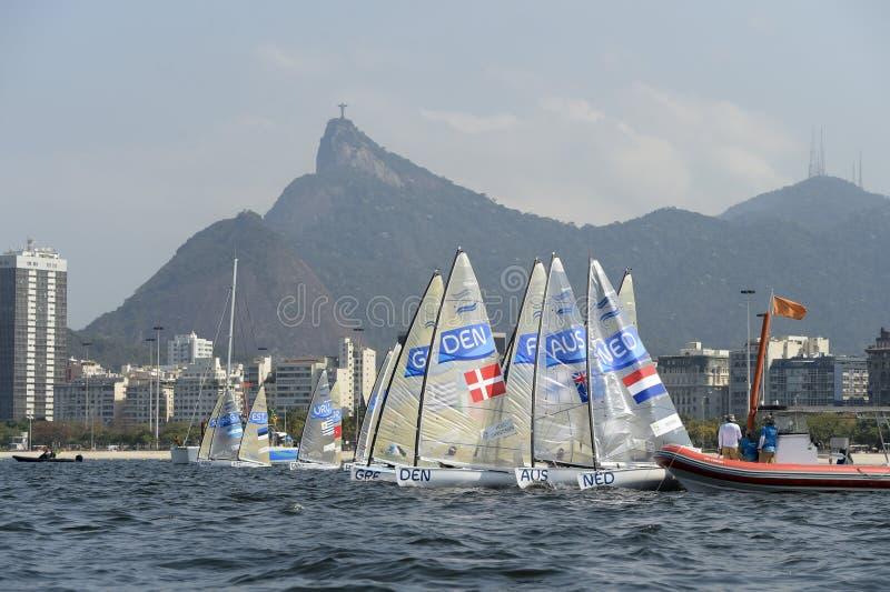 Olympic Games Rio 2016. Rio de Janeiro, Brazil - august 09, 2016: start during Finn class sailboats in the regatta in the Gloria marina at the Rio 2016 Olympic stock photos
