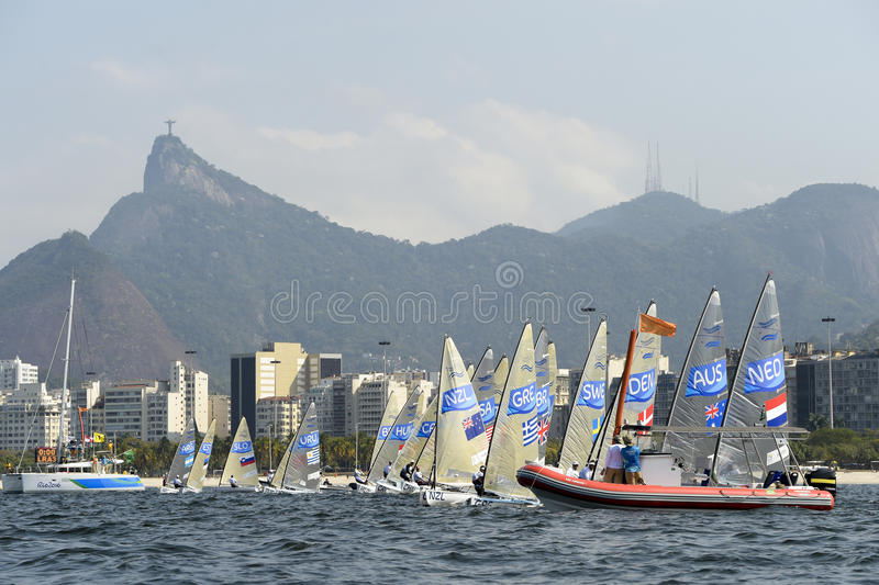 Olympic Games Rio 2016. Rio de Janeiro, Brazil - august 09, 2016: start during Finn class sailboats in the regatta in the Gloria marina at the Rio 2016 Olympic stock photo