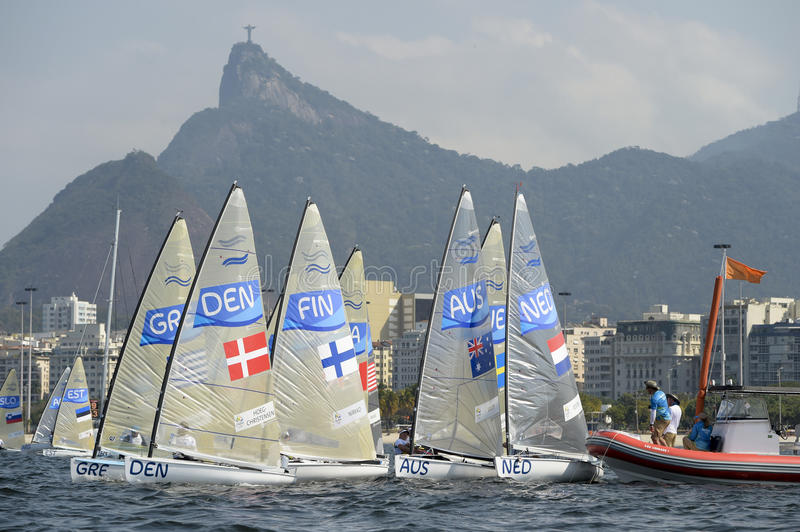 Olympic Games Rio 2016. Rio de Janeiro, Brazil - august 09, 2016: start during Finn class sailboats in the regatta in the Gloria marina at the Rio 2016 Olympic royalty free stock image