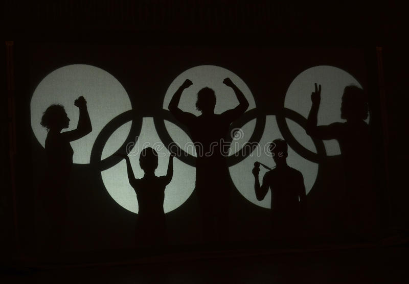 Olympic games spirit. A group of actors impersonate the olympic spirit during the Romanian Olympic Committee centenary held at the Romanian Athenaeum from stock photography