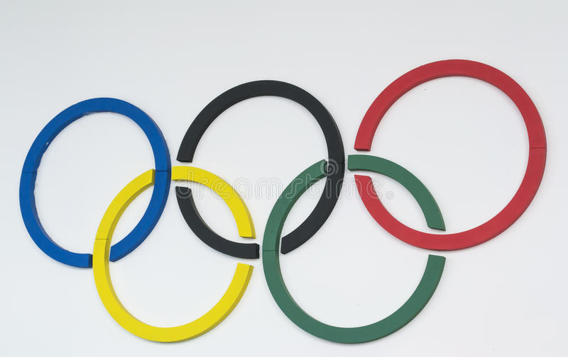 Olympic rings. Five colored custom made circles representing the Olympic symbols , mounted on a white wall stock photography