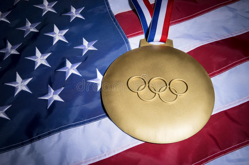 Olympic Rings Gold Medal American Flag stock photo