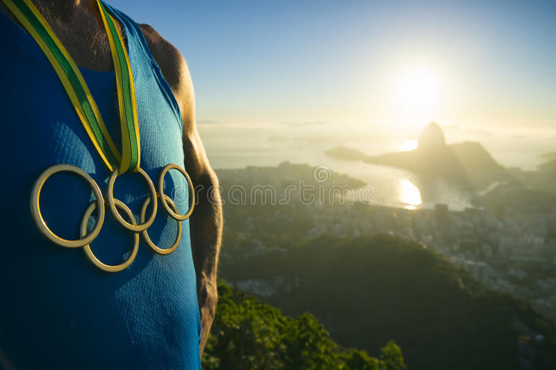 Olympic Rings Gold Medal Athlete Rio de Janeiro Sunrise stock image