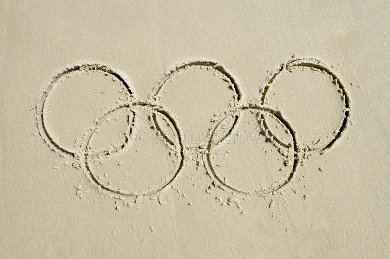 Olympic Rings Message Drawn in Sand royalty free stock photography