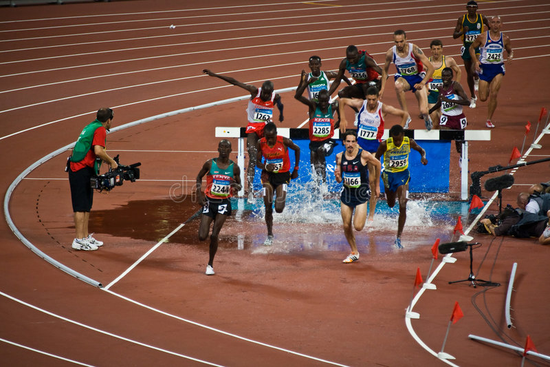 Download Olympic Runners In Men's Steeple Chase Editorial Photo - Image: 6180476