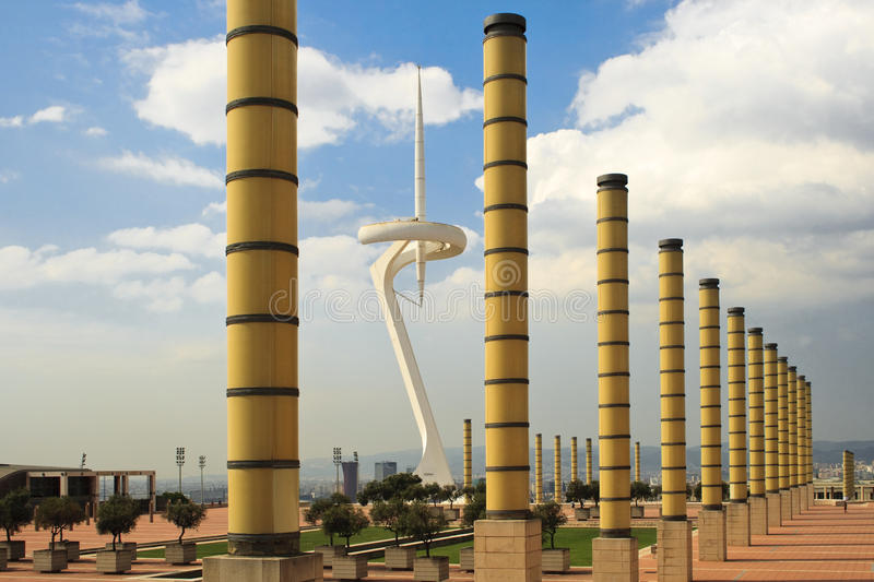 Olympic stadium. Pillars in front of L' Estadi Olímpic (Olympic stadium) of Mont Juic. In the background there is the communication tower of Barcelona (designed stock images