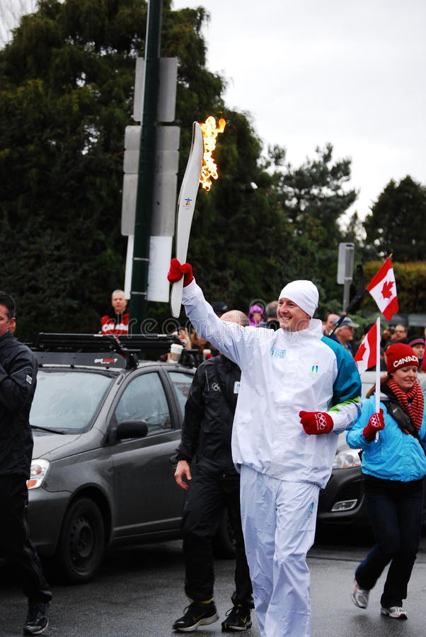 Olympic Torch Bearer Editorial Photo
