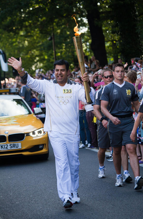 Download Olympic Torch London 2012 editorial stock photo. Image of person - 26381228