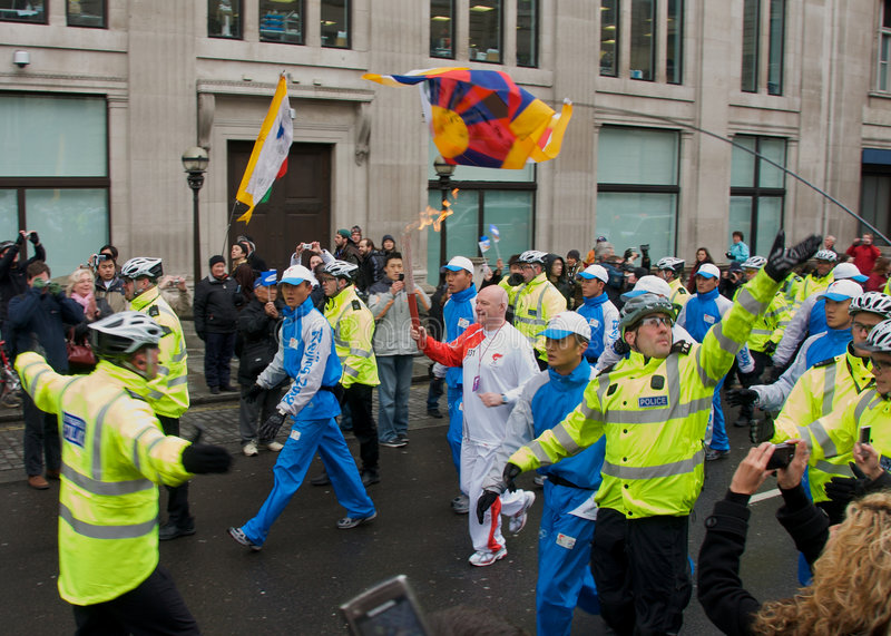 Download Olympic Torch in London editorial photography. Image of cops - 5722742