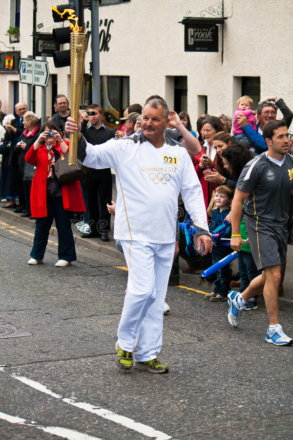 Download Olympic Torchbearer editorial photo. Image of torch, person - 25231406