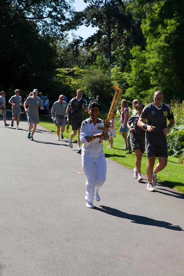 Olympic Torchbearer In Kew Gardens Editorial Image