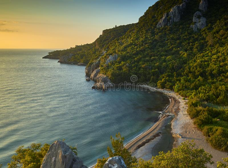 Olympos海滩日落视图 免版税图库摄影