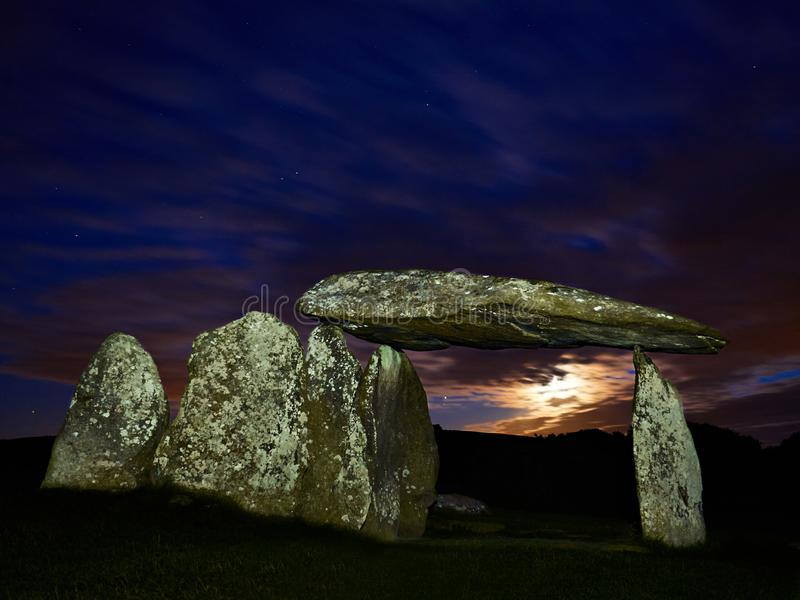 Pentre Ifan Burial Chamber at Moonset. Set in the Preseli Hills and dating back to 3,500 BC it is the largest Neolithic burial chamber in Wales. It is part of a stock photography
